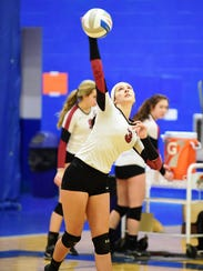 Churchill's Madison Mirabitur goes up for the serve