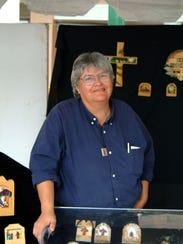 Tomasita Rodriguez of Las Cruces creates painted bultos