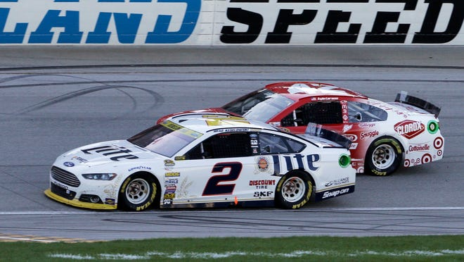 Brad Keselowski (2) drives past Kyle Larson (42) on Sunday at Chicagoland Speedway in Joliet, Illinois.