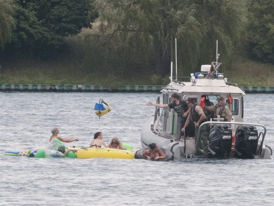 A U.S. Border Protection boat helps floaters on the St. Clair River.