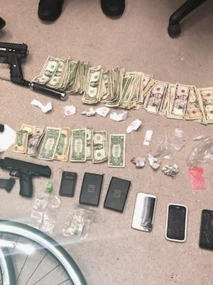 Asbury Park police officials said they seized drugs, cash and weapons on Friday, Nov. 10, 2017, in an investigation involving an alleged threat to a police officer.