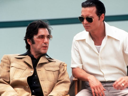"""Al Pacino, left, and Johnny Depp are pictured in the 1997 film """"Donnie Brasco."""""""