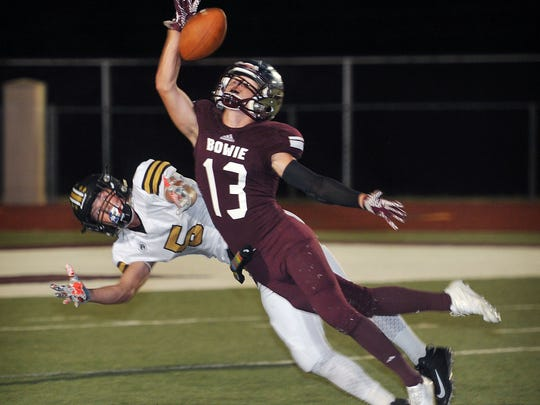Bowie's Jay Rogers (13) breaks up a long pass intended for Henrietta receiver Brody Offield (5) Friday night in Bowie.