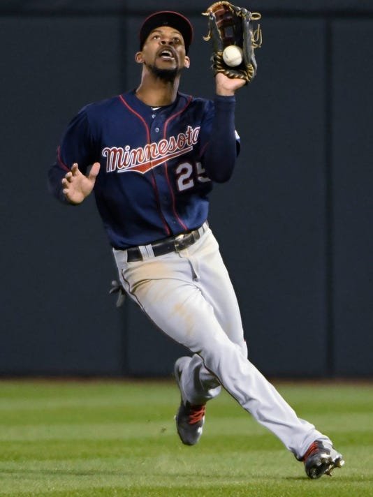 Minnesota Twins center fielder Byron Buxton makes an error on a ball hit by Chicago White Sox's Todd Frazier during the fourth inning of a baseball game, Thursday, May 11, 2017, in Chicago. (AP Photo/David Banks)