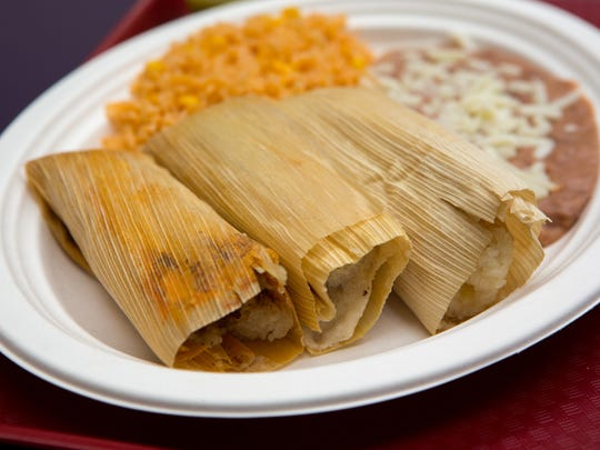 Pork, beef and pineapple tamales  Monday, June 9, 2014, at Tamale's Industry in the Merle Hay Mall in Des Moines.