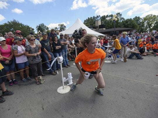 Amanda Outhouse of Defiance races back to her outhouse while participating in the outhouse race at the Iowa State Fair on Tuesday, Aug. 12, 2014, in Des Moines, Iowa.
