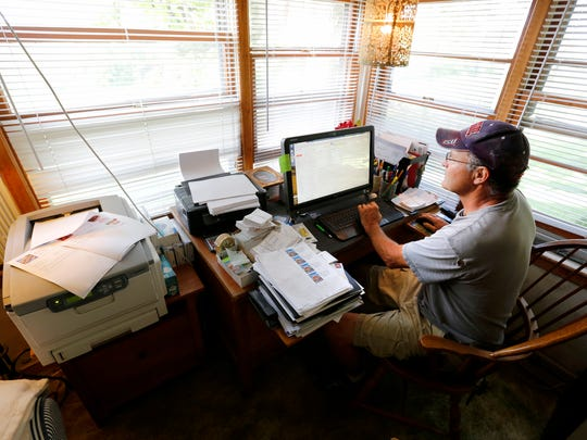 Denny Wimmer  prints a newsletter from his office on his organic farm in Arispe on July 31, 2014.   Wimmer offers a 20-week CSA (community supported agriculture) program and publishes the newsletter with each week's CSA delivery.