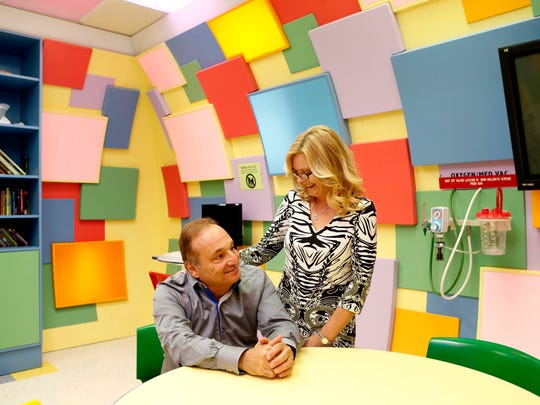 """John and Brenda Fareri are photographed at Maria Fareri Children's Hospital, July 29, 2014 in Valhalla. Their story has been made into a new movie, """"Louder Than Words,"""" which stars David Duchovny and Hope Davis. Their daughter, Maria, died of rabies and the family worked to create the children's hospital in her name."""