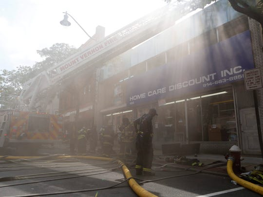 Firefighters battle a basement fire in a furniture and home goods store located at 122 South 4th Avenue in Mount Vernon Sept. 5, 2014. Mount Vernon received mutual aid from Eastchester, Pelham, Pelham Manor and Yonkers.