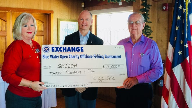 Diana Best, left, and Jeff Slade, members of the Sebastian Exchange Club, present Brother Jim Hinkle of Shiloh Youth Ranch a check for $3,000.