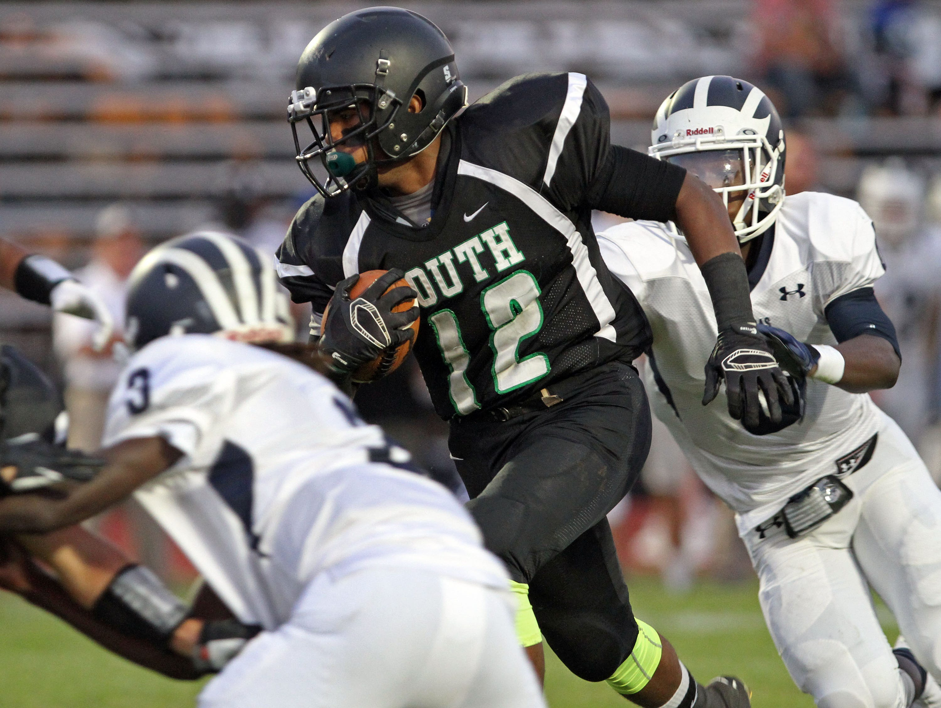 South Plainfield's Jason Lee picks up a first down in football game of New Brunswick at South Plainfield.