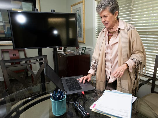 Annalee Leonard, the owner of Mainstay Financial, prepares