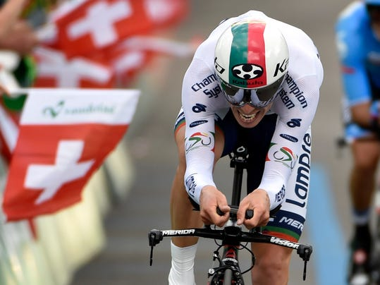 Portugal's Rui Alberto Costa of team Lampre Merida  cycles  during the 7th stage, a 24,5 km race against the clock from Worb to Worb, at the 78th Tour de Suisse UCI ProTour cycling race, in Worb, Switzerland, Friday, June 20, 2014. (AP Photo/Keystone,Peter Schneider)