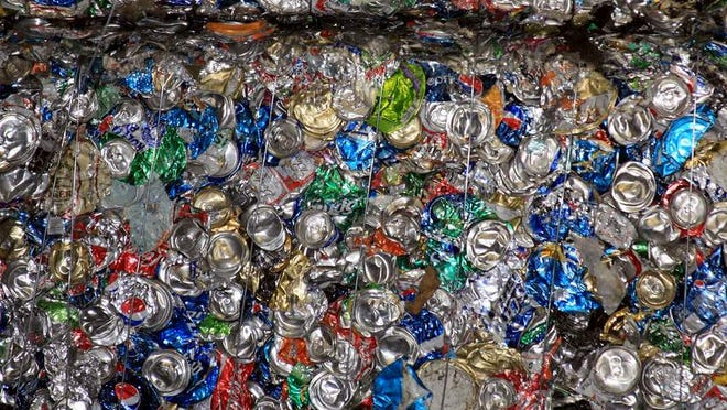 Bales of crushed aluminum cans at Waste Management. (Provided photo)