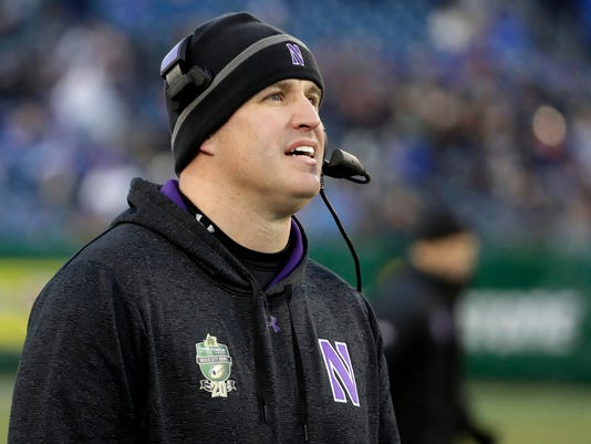 Northwestern head coach Pat Fitzgerald watches from the sideline in the first half of the Music City Bowl NCAA college football game against Kentucky, Friday, Dec. 29, 2017, in Nashville, Tenn. (AP Photo/Mark Humphrey)