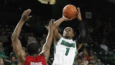 Marshall's Kareem Canty, right, shoots over Western Kentucky's Aaron Adeoye during the second half of an NCAA college basketball game on Tuesday, Nov. 26, 2013, at the Cam Henderson Center in Huntington, W.Va. Canty scored 15 points in Marshall's 74-64 win. (AP Photo/Randy Snyder)