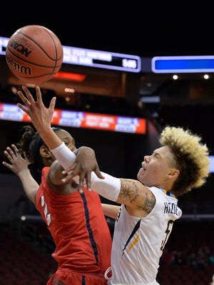Dayton forward Jordan Wilmoth (left) fouls Marquette guard Natisha Hiedeman as she attempts a layup during the second half.