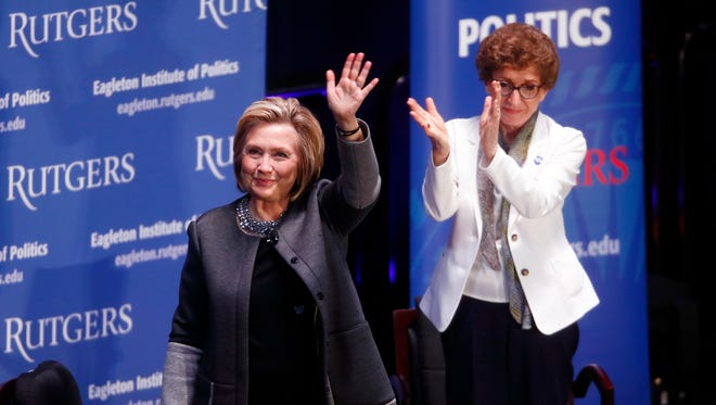 Hillary Clinton waves goodbye after her conversation with Ruth B. Mandel, Director, Eagleton Institute of Politics at Rutgers University, talking about politics, American democracy, her career and womenÕs role in the political movement at the Rutgers Athletic Center.