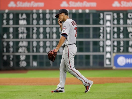 Minnesota Twins' Jose Berrios walks toward the dugout after being pulled during the second inning of the team's baseball game against the Houston Astros on Friday, July 14, 2017, in Houston. (AP Photo/David J. Phillip)