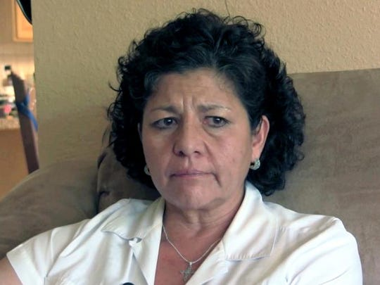 In this July 14, 2015 image from video Tina Cordova speaks from Albuquerque, about her late father, Anastacio Cordova, who she believes was affected by the atomic bomb Trinity Test, in New Mexico.