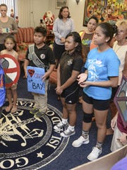 Gov. Eddie Calvo meets with school students and other protests in his office at Adelup on Friday, Dec. 11.