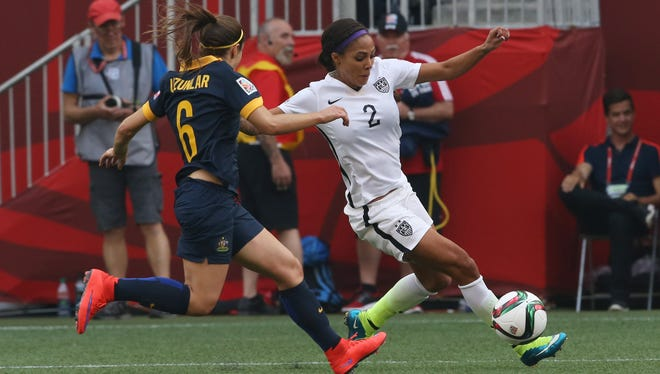 Sydney Leroux, right, shown here playing in last year's World Cup, scored a goal in the three matches she played last spring for the WNY Flash. She was traded to FC Kansas City on Wednesday.
