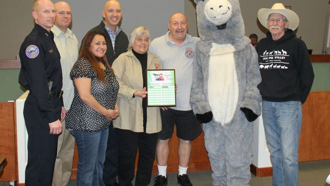 The Parade of Homes presented the award for The Most Food Gathered to the Mesquite Police Department and the Peaceful Valley Donkey Rescue won for the best parade entry during the January 12 city council meeting.