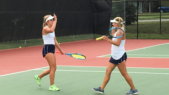 Seaman's No. 1 doubles team of Grace Unruh, left, and Lauren Sweeney celebrate a point in Tuesday's Washburn Rural Invitational tennis tournament. Unruh and Sweeney won the tournament championship.