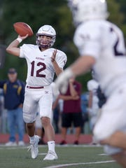 Aquinas quarterback Jon Kloch throws a screen pass.