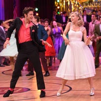 "Juliane Hough, right, and Aaron Tveit appear during a performance of ""Grease: Live!"""