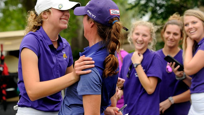 Wylie's Maddi Olson (left) gets a hug from her mother, Stephanie, after finishing the Class 4A UIL state golf tournament on Tuesday, May 16, at Horseshoe Bay Resort's Slick Rock golf course. Olson shot 70-76 to win by one shot over Bridgeport's Brooke Irion.