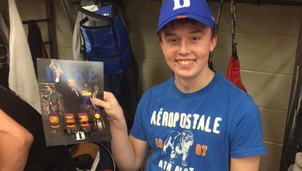 Pisgah junior Matthew Poole with the hat and signed photo he received from Duke basketball coach Mike Krzyzewski.