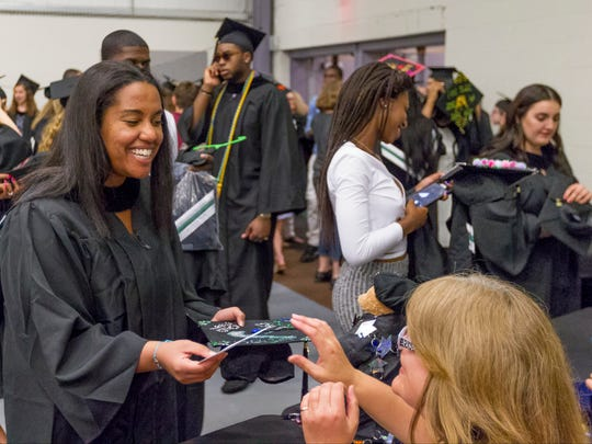 Courtney Oberosler of Monticello checks in with Deborah Fedenko, right, at the start of graduation ceremonies, Thursday evening at Cortland Community College in Dryden. Oberosle majored in criminal justice and Fedenko is the faculty suit secretary at the college.