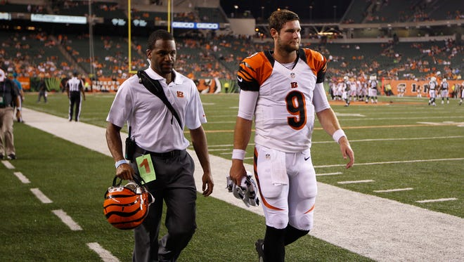 Cincinnati Bengals quarterback Tyler Wilson (9) heads to the lockeroom after a big hit against the New York Jets at Paul Brown Stadium. The Enquirer/Jeff Swinger