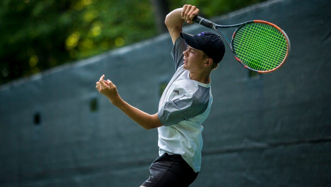 St. Clair native Gabe Brown, 13, returns the ball during the Francis J. Robinson Memorial International Tennis Tournament Wednesday, August 3, 2016 at Sanborn Park in Port Huron.