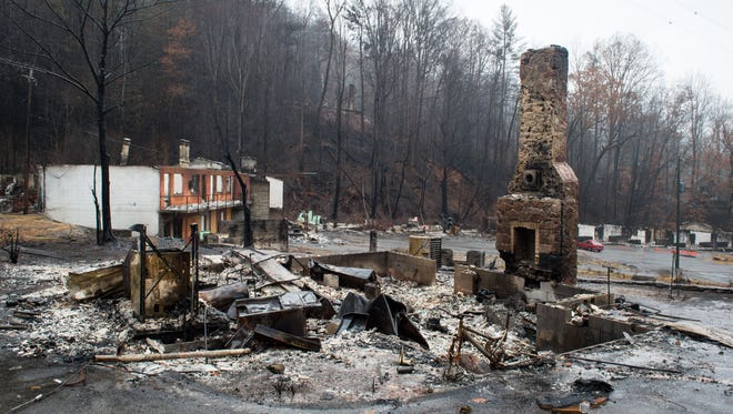 Destroyed buildings on Ski Mountain Road, Tuesday, Dec. 6, 2016, in Gatlinburg, Tenn.