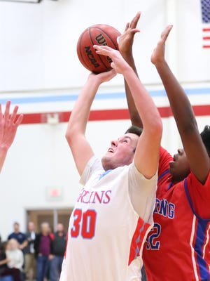 USJ's Trey Corley gets fouled by Harding Academy defender Tuesday night at USJ for the Division II-A West region quarterfinal.