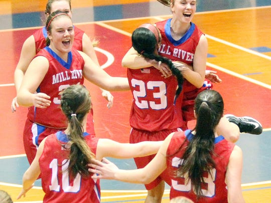 Mill River's Ella Bankert, right, is lifted into the air by teammate Mariz Mangundayao during the celebration following the Minutemen's 50-46 win over Lake Region in the Division II high school girls basketball state championship at Barre Auditorium on Saturday, Feb. 28, 2015.