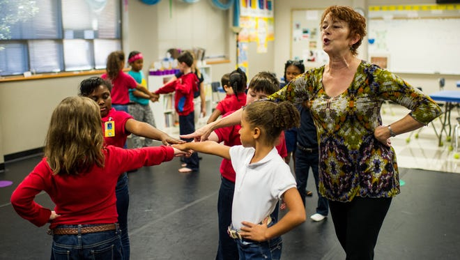"Mary Francis ""Cissy"" Whipp, at right, leads a third grade class in a dance routine at J. Wallace James Elementary School in Lafayette, La., Thursday, Nov. 19, 2015."