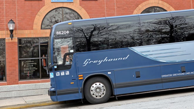 A Greyhound bus prepares to leave the Wilmington Bus station on Nov. 15, 2013. Greyhound has agreed to pay over $300,000 to customers with disabilities.