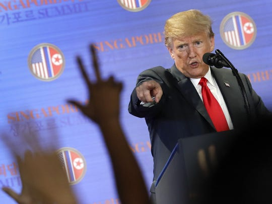U.S. President Donald Trump answers questions about the summit with North Korea leader Kim Jong Un during a press conference at the Capella resort on Sentosa Island Tuesday, June 12, 2018 in Singapore. (AP Photo/Wong Maye-E)