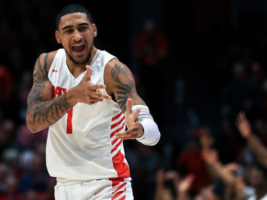 FILE - In this Feb. 11, 2020, file photo, Dayton's Obi Toppin (1) reacts in the first half in an NCAA college basketball game against Rhode Island in Dayton, Ohio. Toppin was selected to The Associated Press All-America first team, Friday, March 20, 2020. (AP Photo/Aaron Doster, File)