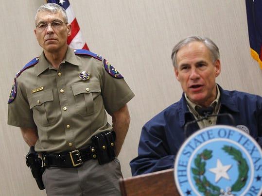 Texas Department of Public Safety Director Steve McCraw stands behind Texas Governor Greg Abbott as Abbott talks about his border security plan during a news conference Friday,  March 27, 2015 at DPS' Region 3 Headquarters in Weslaco, Texas.