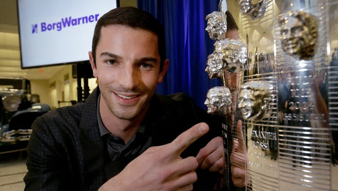 Alexander Rossi poses for photos following the unveil of his likeness on the Borg-Warner Trophy 2016 Indianapolis 500 winner Wednesday, December 7, 2016, at the Indianapolis Motor Speedway Museum