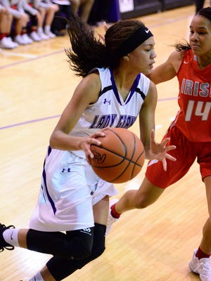 Jazmin Bulger, handling the ball against Central Catholic, had 20 points and nine rebounds Monday as Fremont Ross beat Mansfield Madison.