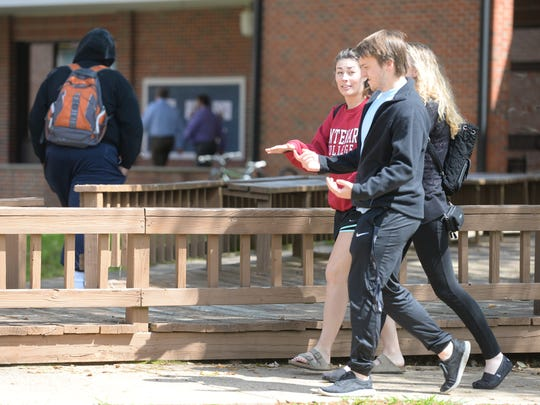 Students chat Friday while walking to class at Centenary