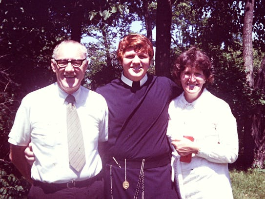 Joseph Tobin poses with his parents when he was studying