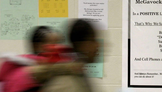 File photo of students passing by a sign at McGavock High in Nashville, Tenn., on Monday, Oct. 24, 2006.