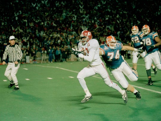 Dec. 5, 1992: Alabama cornerback Antonio Langham (43) intercepts a pass from Florida's Shane Matthews and outruns Jason Odom (74) for the game-winning touchdown in the first SEC Championship game.