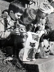 Halloween goblins from Price Hill check their loot in 1966.